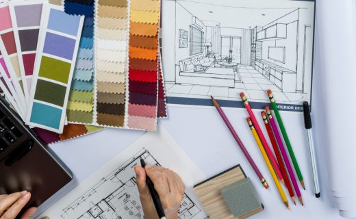architects-interior-designer-hands-drawing-of-house-on-creative-desk-000072157623_full